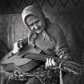 worship old woman guitar