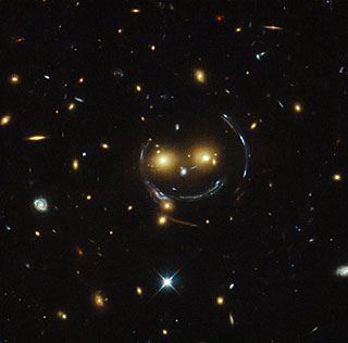 Smiling Face 2 galaxies SDSS J1038+4849 Photo Hubble Telescope NASA