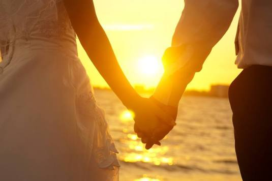 husband wife hold hands sunset couple man woman
