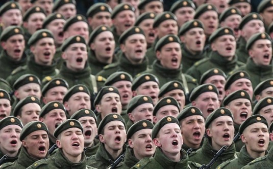 MOSCOW REGION, RUSSIA. APRIL 22, 2015. Russian Army soldiers chant as they march in formation at Alabino during a rehearsal of the upcoming 9 May Victory Day Parade. Sergei Savostyanov/TASS