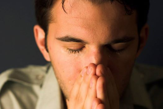 man crying praying
