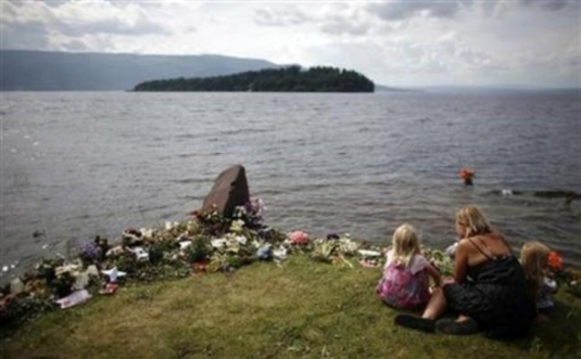 (Reuters/Stoyan Nenov)A woman and her daughters sit near flowers left on a memorial on the shore of Tyrifjorden lake, near Utøya island August 1, 2011, where anti-Islam extremist Anders Behring Breivik killed 68 people in a shooting rampage in July.